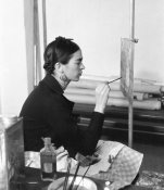 photographer unknown - Frida Kahlo seated at an easel, November 30, 1932