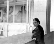 photographer unknown - Frida Kahlo on a balcony above the work-in-progress Detroit Industry murals at the DIA, 1932
