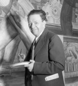 photographer unknown - Diego Rivera posed while working on the North Wall of his Detroit Industry murals at the DIA, 1933