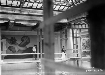 photographer unknown - Diego Rivera and Frida Kahlo on scaffolding in front of the work-in-progress Detroit Industry murals, DIA, 1932
