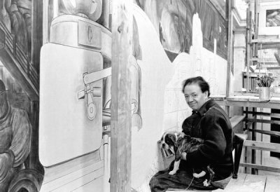 photographer unknown - Diego Rivera posing with a dog while working on the North Wall of his Detroit Industry murals at the DIA, 1932